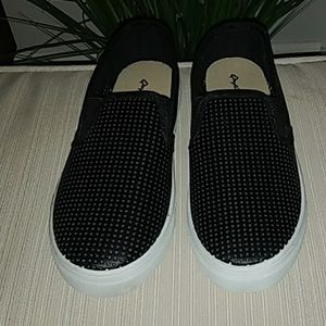 Black slip on with white sole and cut out pattern